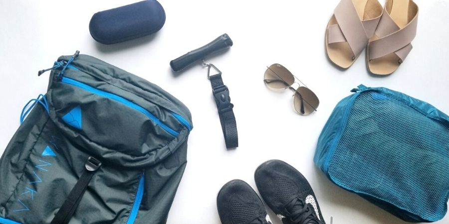 Travel light tips: weigh your packed bag with a handheld luggage scale at home