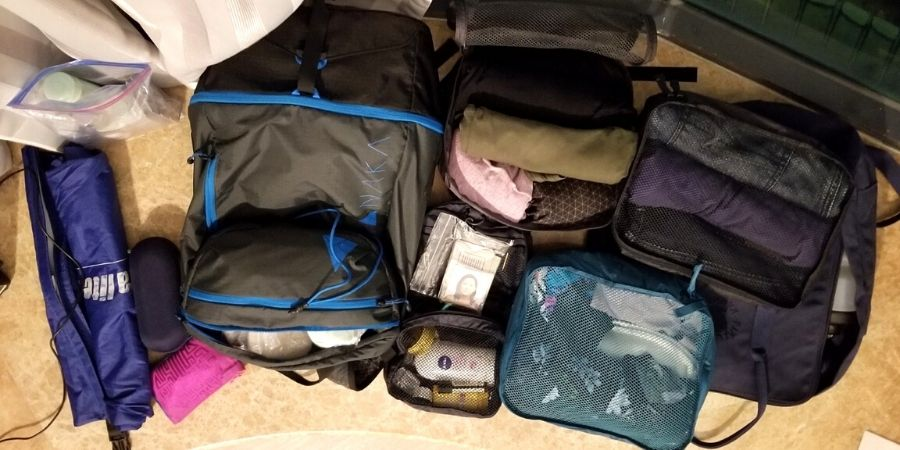 The contents of my 7kg cabin size backpack. I live with all these items for the entire duration of my trip