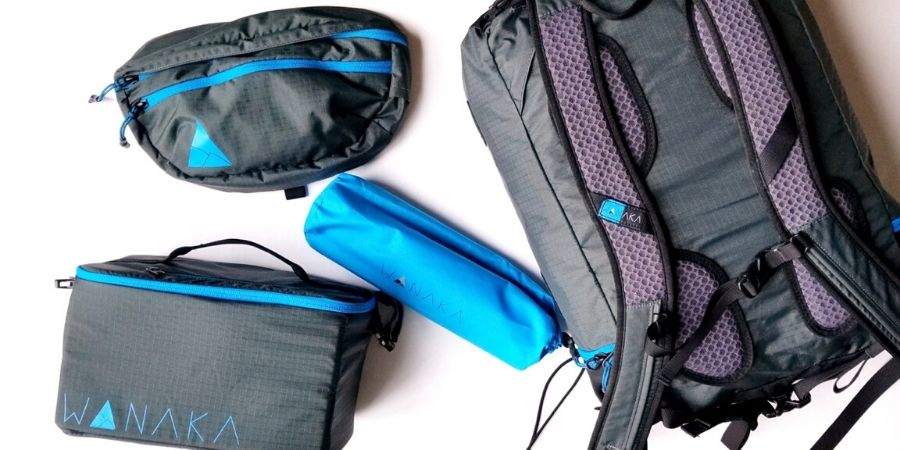 Wanaka Adapt Backpack includes a fanny pack/adventure sling, inflatable frame and camera bag/cooler.