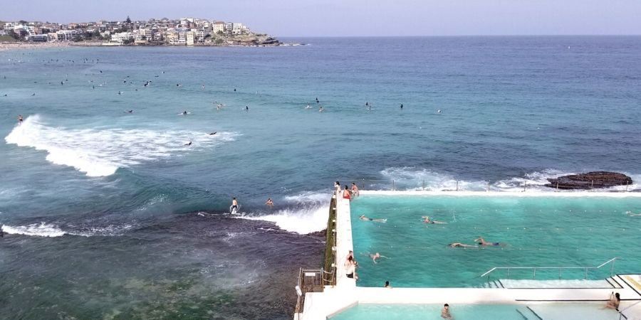 Background: North Bondi Beach. Foreground: Bondi Icebergs pool