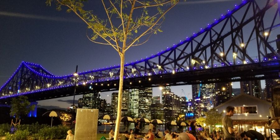 Enjoy a balmy summer night at the base of Story Bridge in Brisbane.