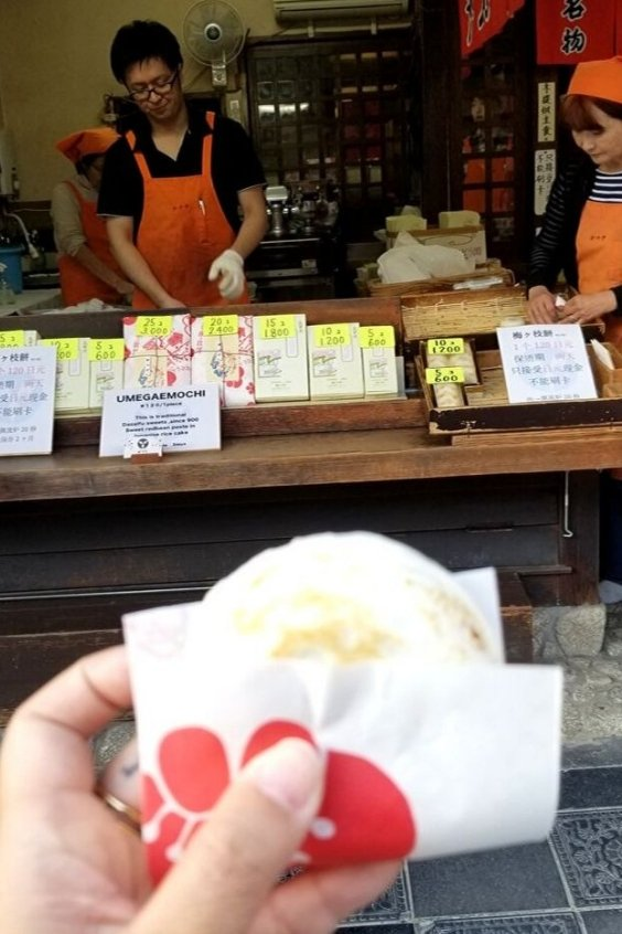 Buy an umegae mochi on the main shopping street in Dazaifu.