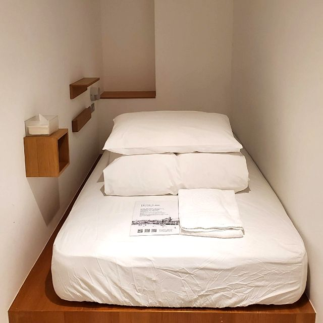 Each dormitory guest room has a platform bed, few shelves, a safe and a nightlight.
