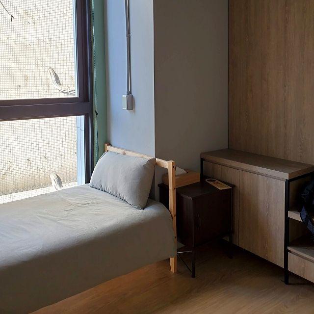 A private single bedroom at Kafnu Taipei.