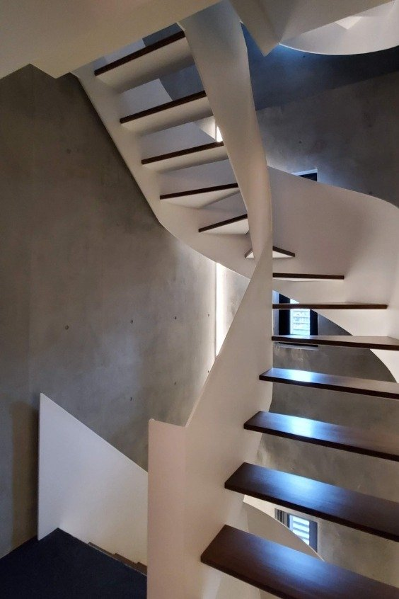 The building of the boutique hotel has a beautiful and functional staircase.