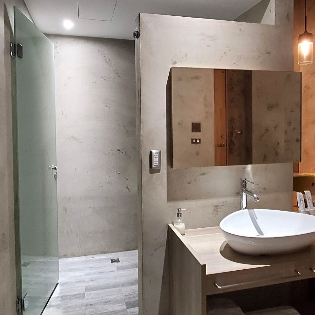 The king room has an open concept bathroom where the vanity is part of the room.