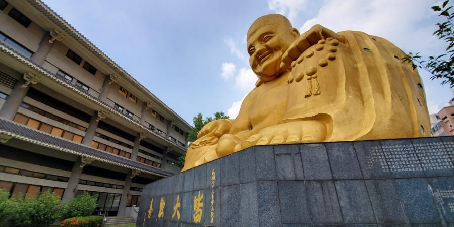 Visit the giant golden laughing Buddha at Paochueh Temple in Taichung.