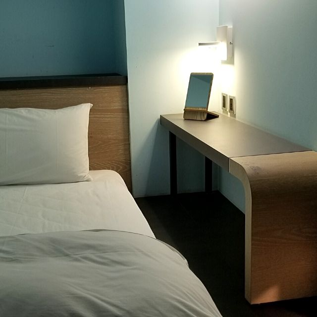 The individual dorm bed at the Taiwan Youth Hostel & Capsule Hotel includes a small desk, a large locker and lights.