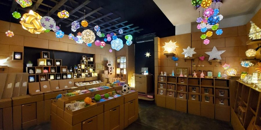 Find different types of paper lanterns at the back of the souvenir shop.