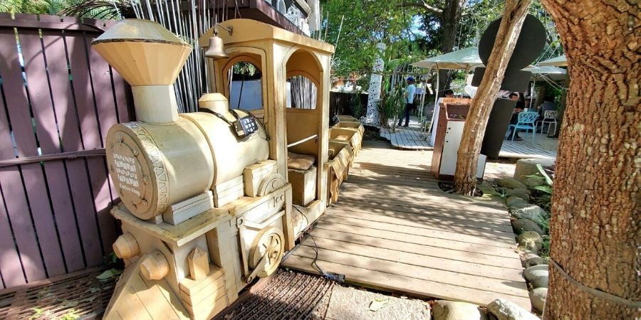 The cardboard train loops around the park in Carton King