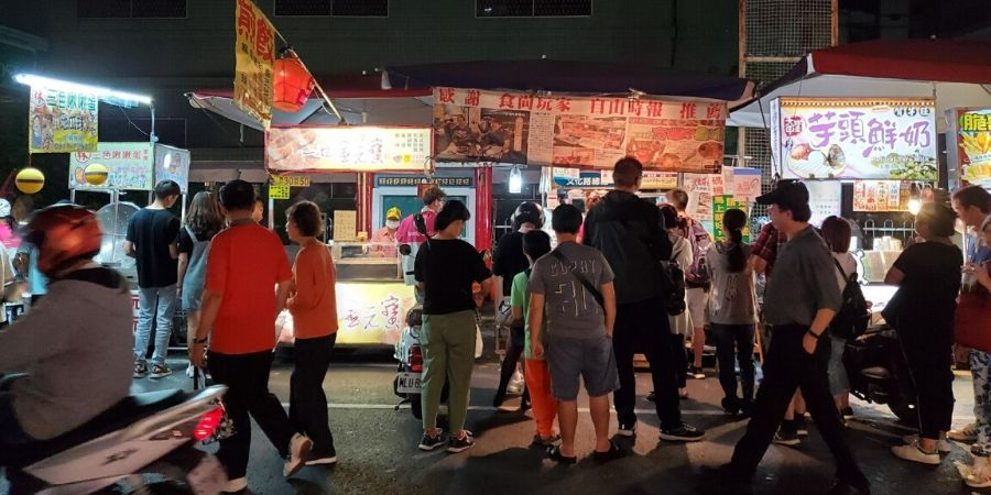 Be careful of cars and motorcycles while you are browsing through the food stalls of Wenhua Night Market.