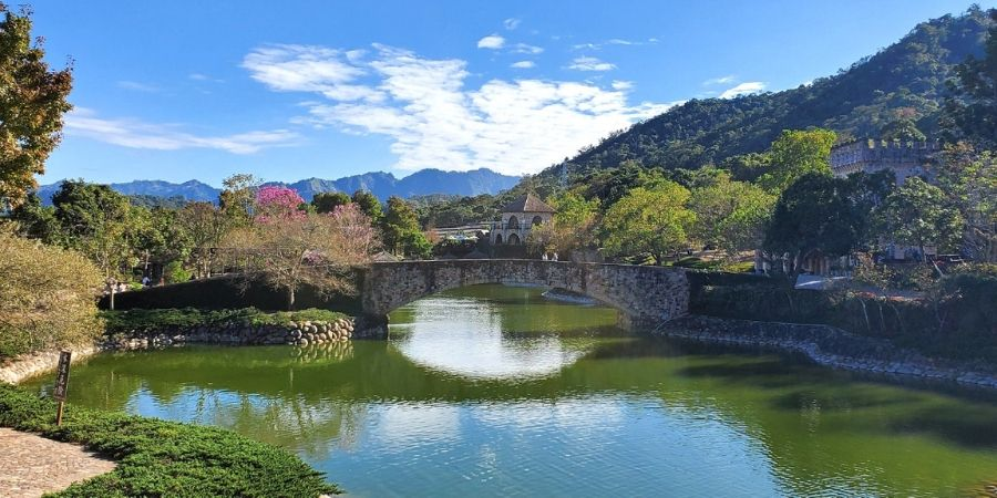 Rainbow bridge sits in the middle of the pond at Xinshe Castle, Taiwan.