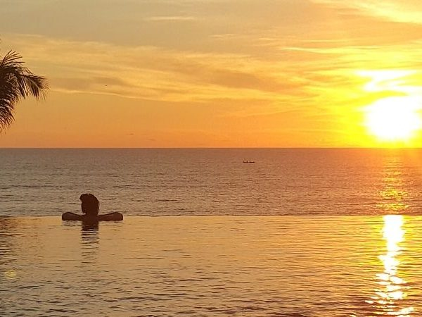 One of the best things to do in Seminyak Bali: watch sunset from the infinity pool of Alila Seminyak.